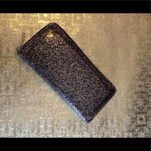 Gold speckled wallet with gold hardware